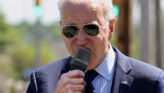 Reporters Cheer As Biden Takes Huge Bite Out Of Microphone Mistaking It For Ice Cream